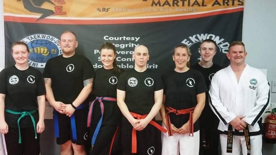 Denny Kickboxing students posing for photo