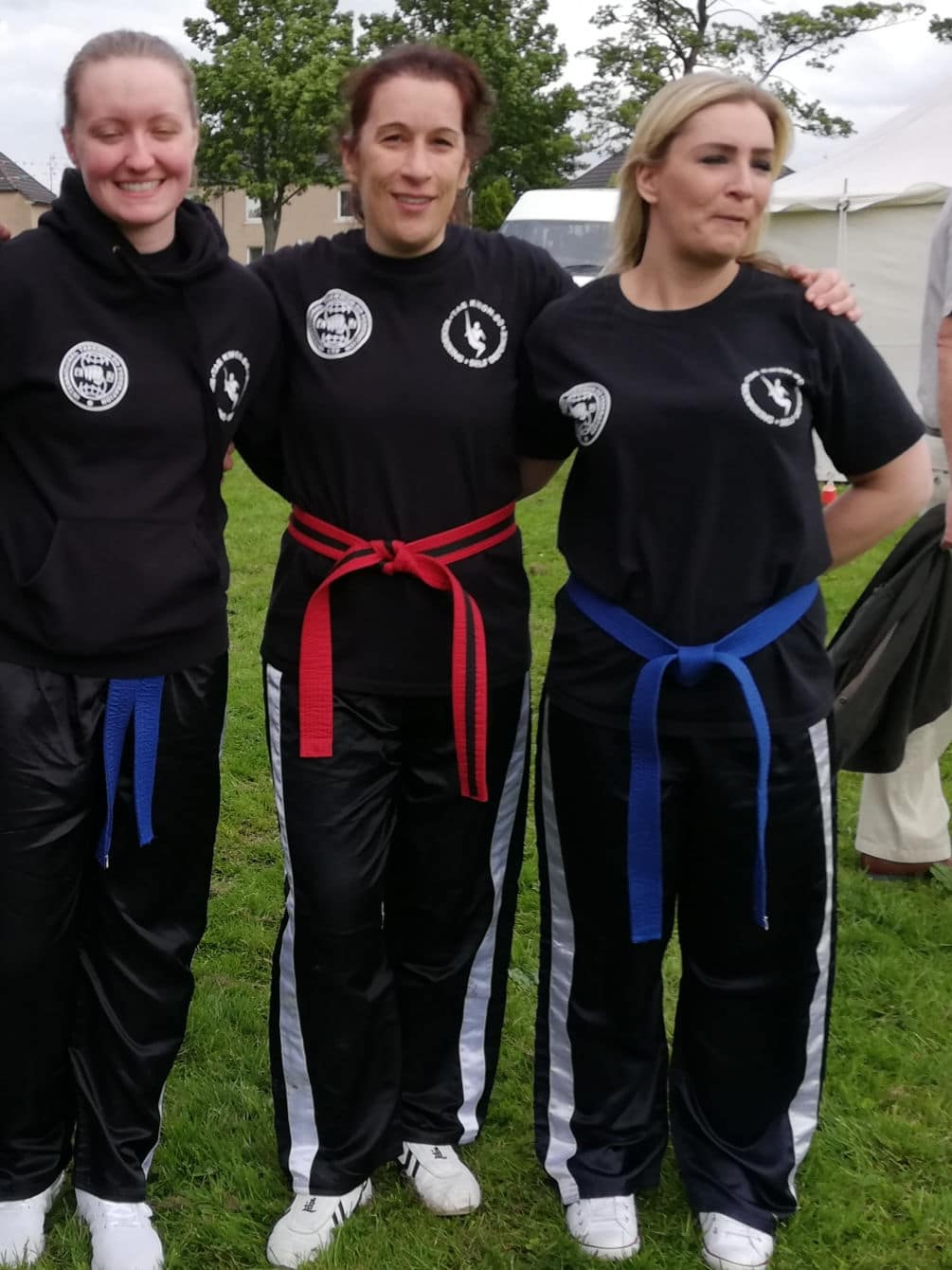 3 female self-defence students outside smiling for photo
